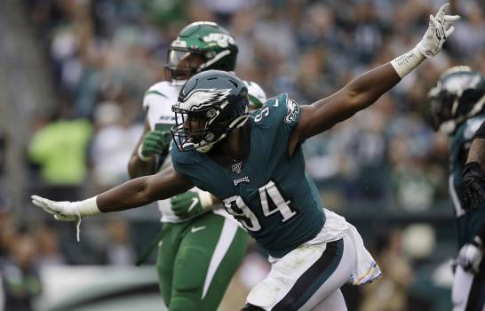 Josh Sweat of the Philadelphia Eagles celebrates after capturing Luke Falk of the New York Jets on Sunday, October 6, 2019