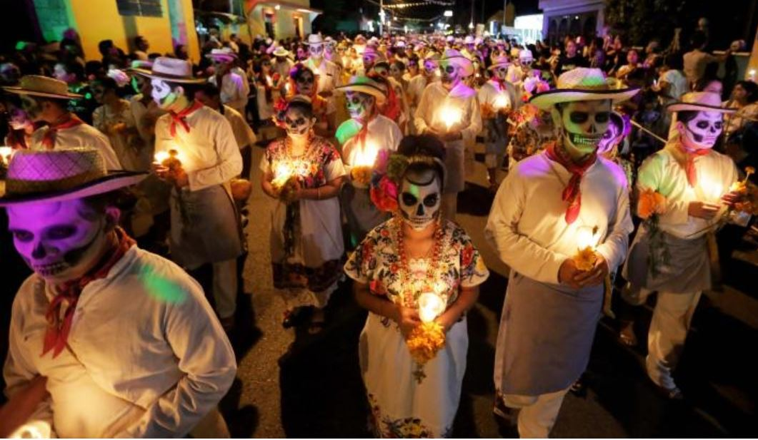 Skeletons walk among the living at Day of the Dead